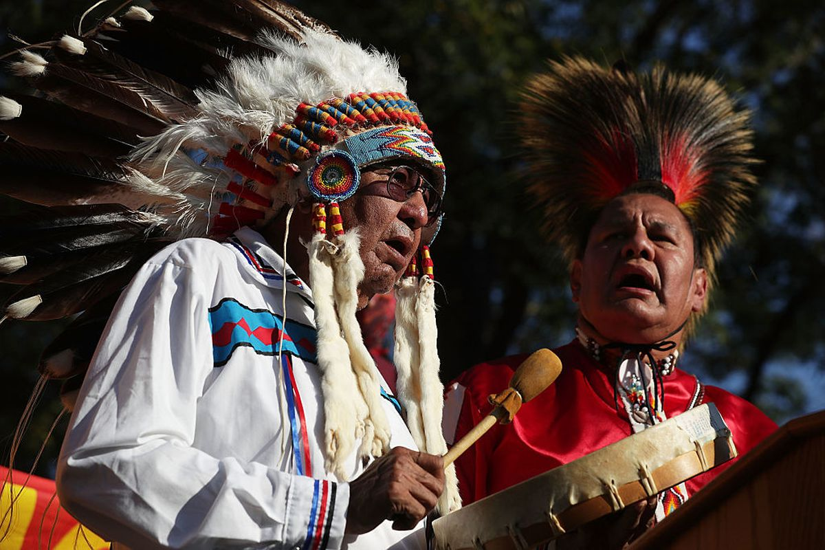 Dennis Zotigh and his father Ralph Zotigh of the Kiowa, Dakota, and Pueblo Tribes sing during a rally against the Dakota Access Pipeline