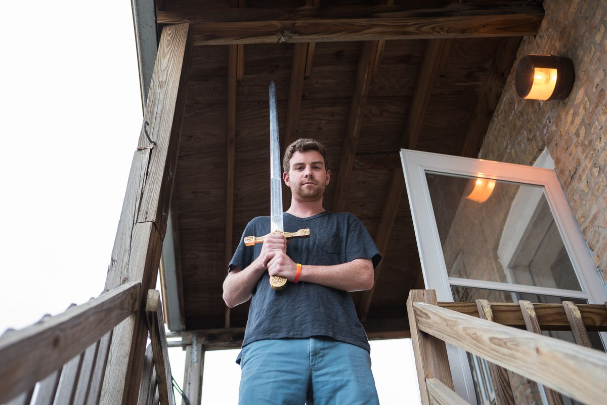Mac Dolan outside his Wicker Park apartment with a Medieval Times sword he used to scare off an intruder who was trying to rape a female guest sleeping on his couch.