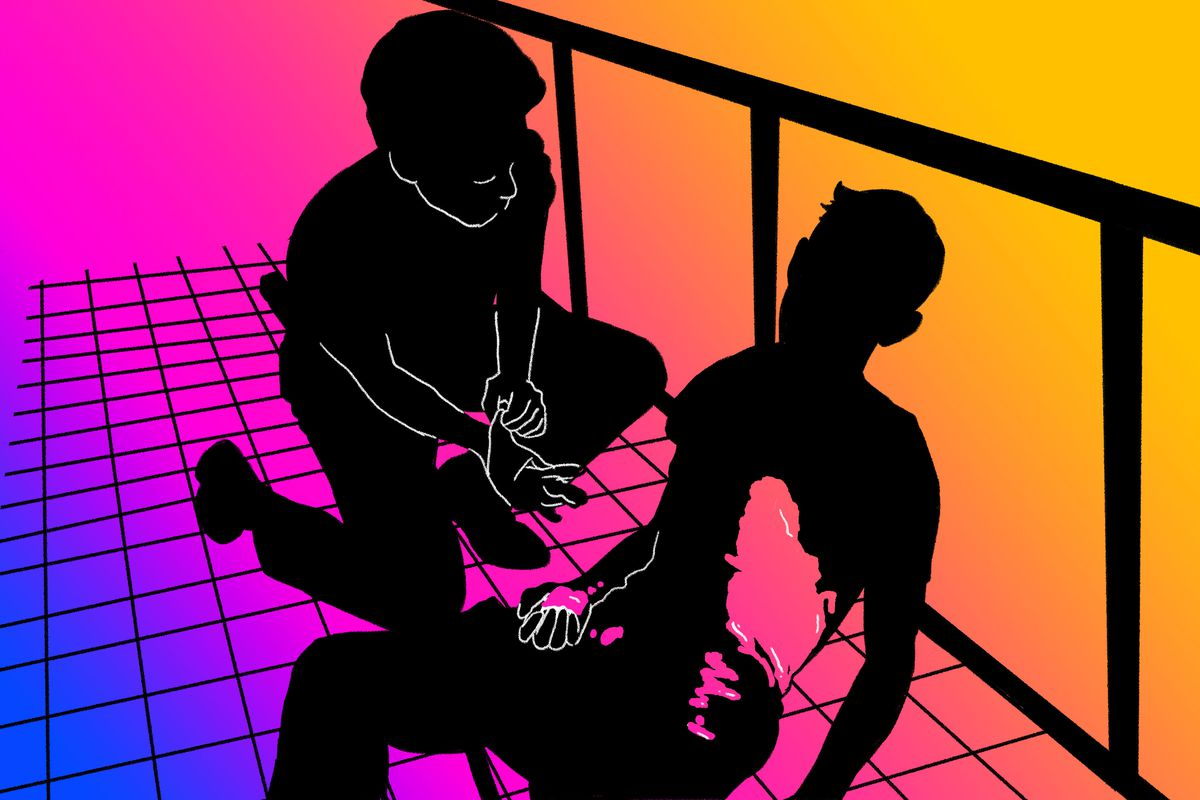 Silhouettes of two medics surrounding a man on the floor