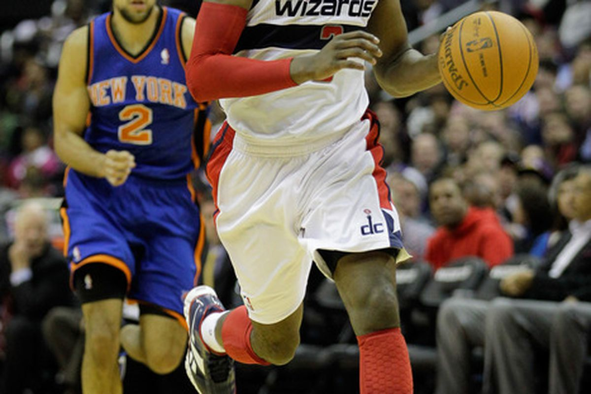 John Wall of the Washington Wizards brings the ball up the court against the New York Knicks during the second half at Verizon Center on January 6, 2012 in Washington, DC. (Photo by Rob Carr/Getty Images)