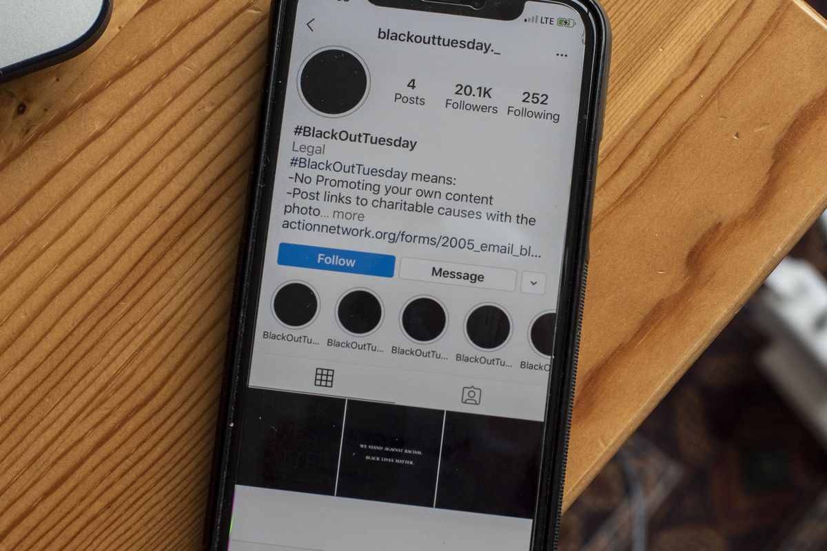 A phone showing the Instagram page for Blackout Tuesday