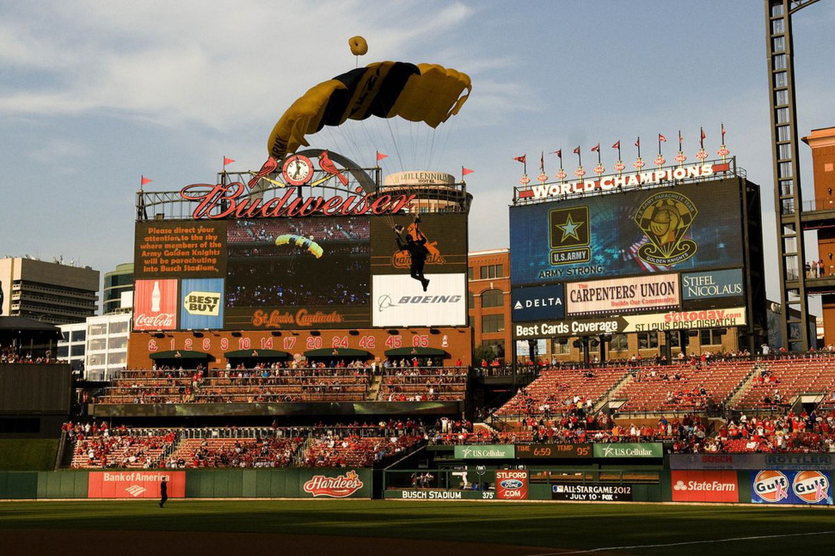 July 3, 2012; St. Louis, MO. USA; The US Army Parachute Team Golden Knights fly into Busch Stadium before a game between the St. Louis Cardinals and the Colorado Rockies. Mandatory Credit: Jeff Curry-US PRESSWIRE