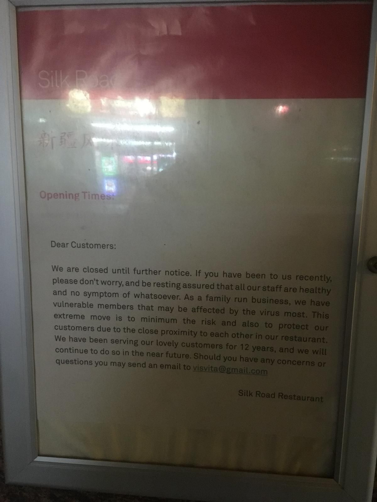 A sign announcing temporary closure of the Silk Road restaurant in Camberwell