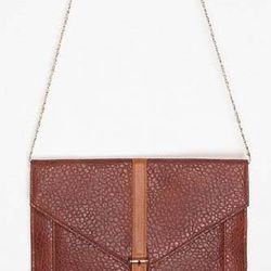 """<a href=""""http://www.urbanoutfitters.com/urban/catalog/productdetail.jsp?id=23870793""""><b>Urban Outfitters</b> Ecote Pebbled Envelope Clutch</a>, $34.99 (was $39)"""