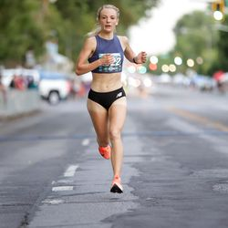 Lexie Thompson finishes second in the women's division of the Deseret News 10K at Liberty Park in Salt Lake City on Friday, July 23, 2021.