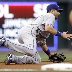 Los Angeles Dodgers third baseman Casey Blake (23) fields a ground ball hit by Cincinnati Reds' Scott Rolen (27) for an out.