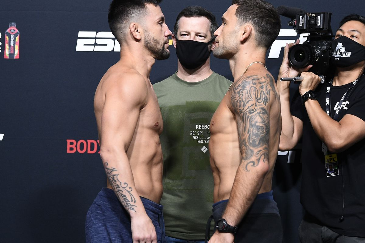 Opponents Pedro Munhoz of Brazil and Frankie Edgar face off during the UFC Fight Night weigh-in at UFC APEX on August 21, 2020 in Las Vegas, Nevada.