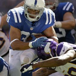 Indianapolis Colts' Donald Brown (31) is tackled by Minnesota Vikings' Chris Cook during the second half of an NFL football game in Indianapolis, Sunday, Sept. 16, 2012.