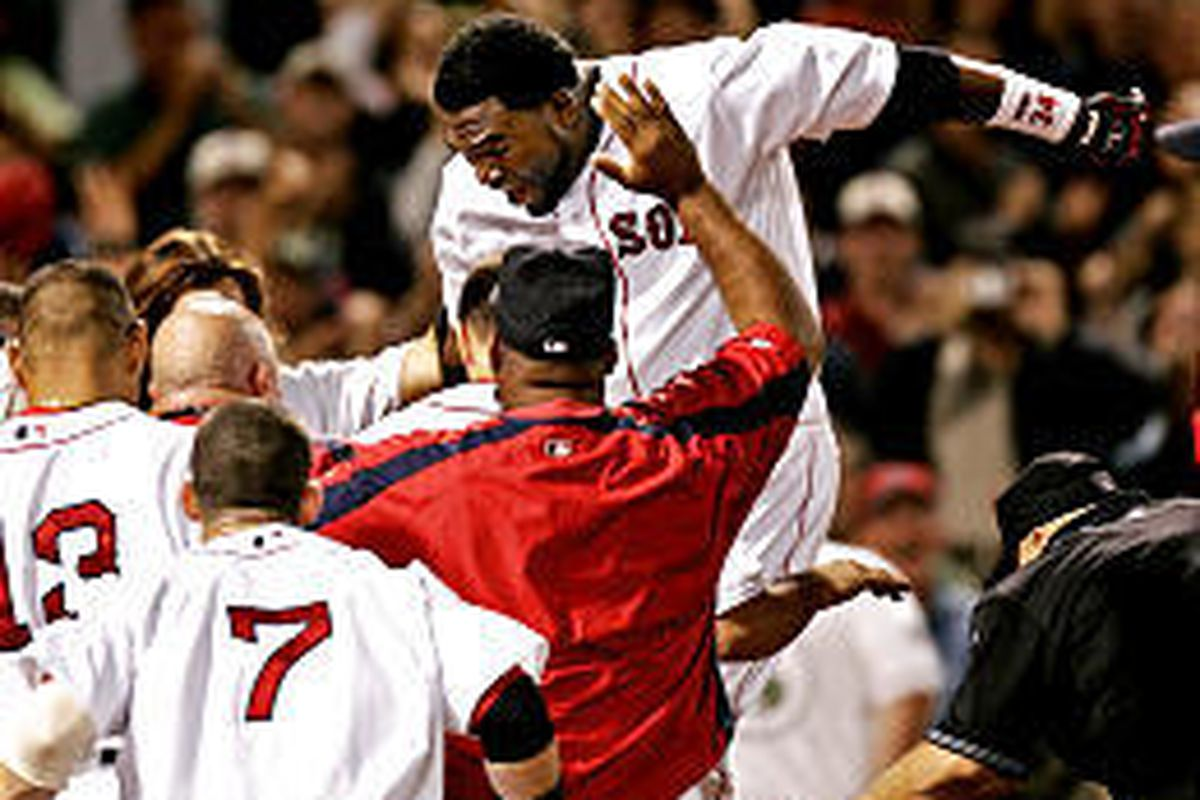 Boston's David Ortiz leaps onto home plate after hitting a walk-off home run to beat the Angels.