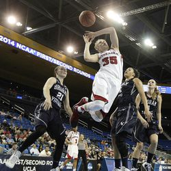 Nebraska's Jordan Hooper (35) is fouled by BYU's Lexi Eaton (21) during the second half of a second-round game in the NCAA women's college basketball tournament on Monday, March 24, 2014, in Los Angeles. BYU won 80-76. (AP Photo/Jae C. Hong)