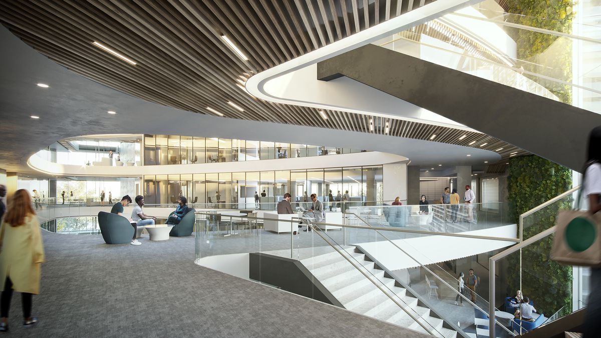 An interior rendering shows a winding modern staircase and communal work space.