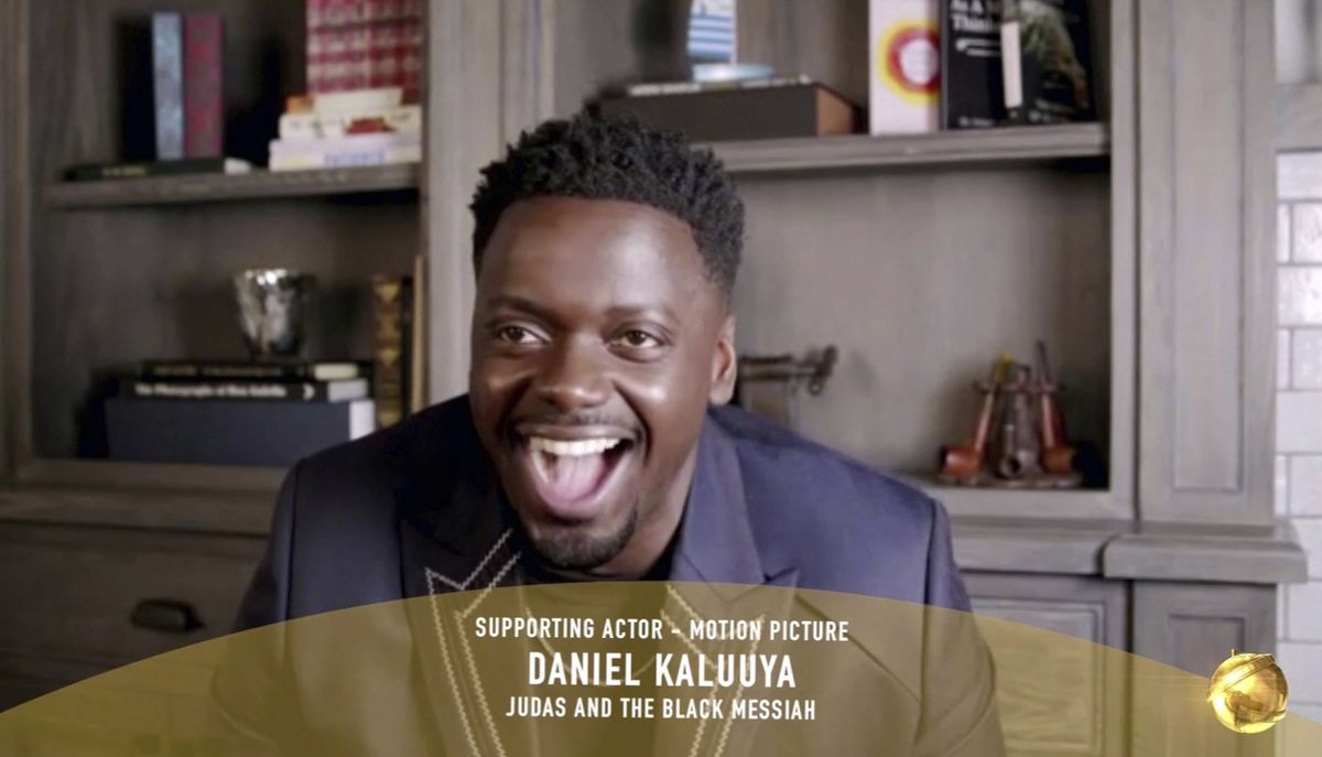 """In this video grab issued Sunday, Feb. 28, 2021, by NBC, Daniel Kaluuya accepts the award for best supporting actor in a motion picture for """"Judas and the Black Messiah"""" at the Golden Globe Awards."""