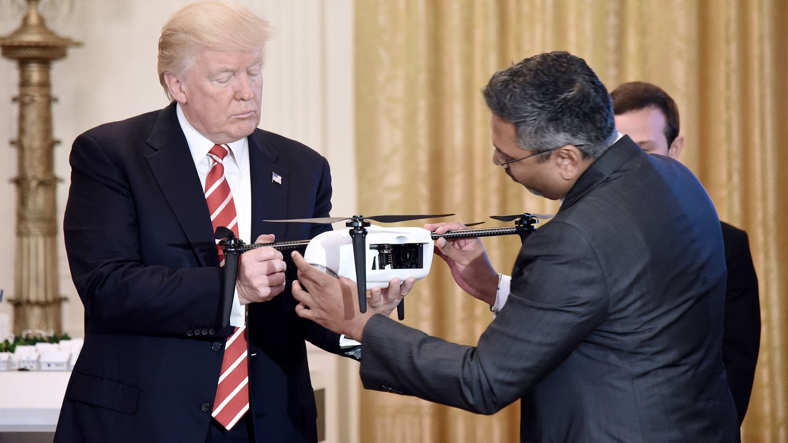 Wireless and drone execs praised President Trump as he pledged to cut down regulations