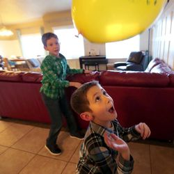 Luke and Oliver Widdison play with a balloon at their home in Saratoga Springs, Utah, Friday, Jan. 8, 2016.