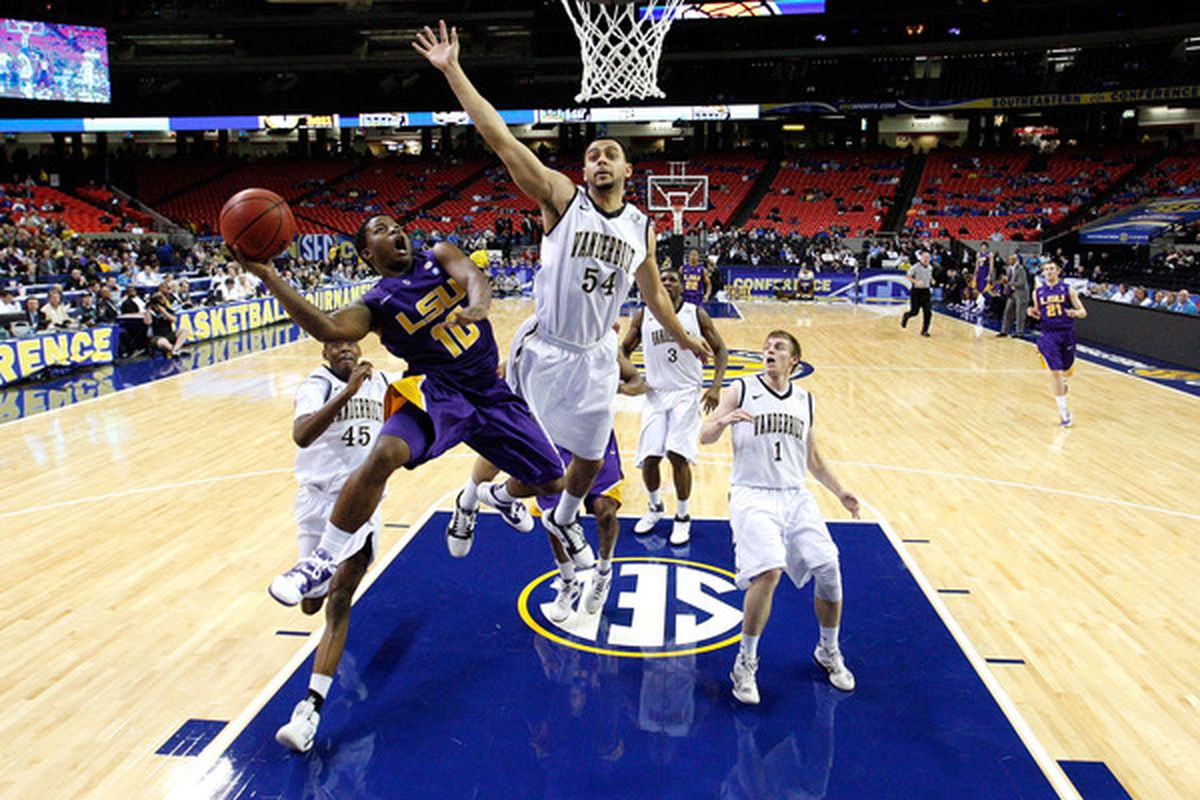 ATLANTA, GA - MARCH 10:  Andre Stringer #10 of the LSU Tigers shoots against Andre Walker #54 of the Vanderbilt Commodores during the first round of the SEC Men's Basketball Tournament at the Georgia Dome on March 10, 2011 in Atlanta, Georgia.