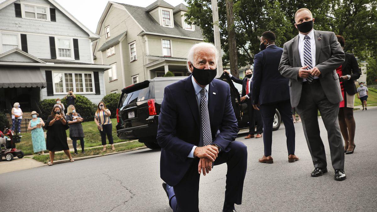 Joe Biden kneeling on the street.