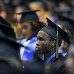 A Salt Lake Community College graduate listens to speakers during the 2017 commencement ceremony at the Maverik Center in West Valley City on Friday, May 5, 2017.