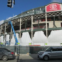 11:49 a.m. The Addison Street side of the front of the ballpark. Some of the tarps have been moved aside to allow work to continue -