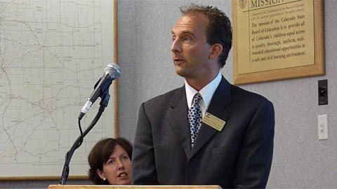Bill Bonk of CDE discusses growth statistics at Aug. 10 news conference. Assistant Commissioner Jo O'Brien is to his left.