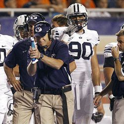 'At center of photo, head coach Bronco Mendenhall of the Brigham Young Cougars gestures during NCAA football in Boise, Thursday, Sept. 20, 2012.