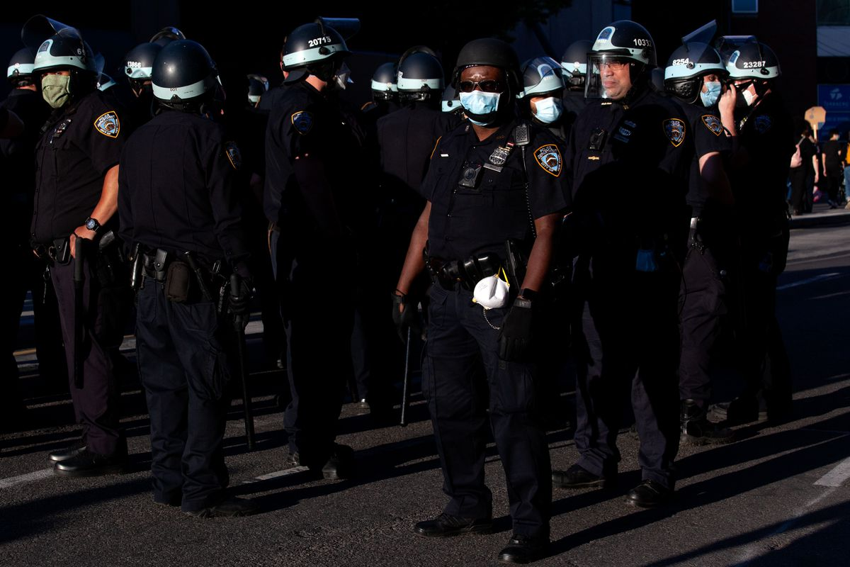 NYPD officers followed protesters as they marched along Atlantic Avenue, May 31, 2020.