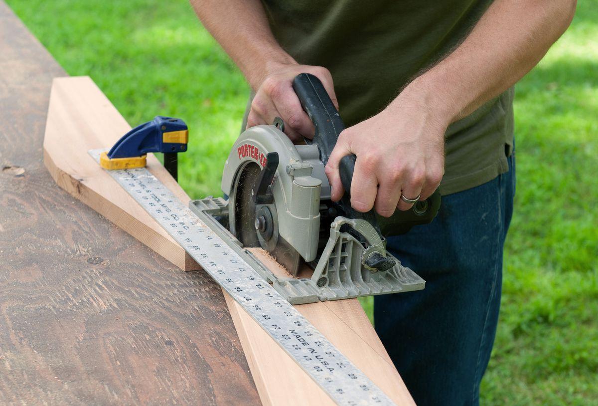 Man Makes Cuts Of Picnic Table With Circular Saw