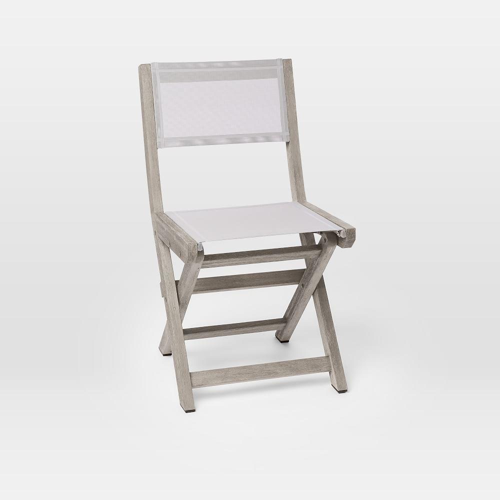 Beige folding chair.