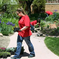 Key Bank employee Laura Hendrickson works in the GEM Court Garden of the George E. Wahlen Department of Veterans Affairs Medical Center at Key Bank's national Neighbors Make The Difference Day in Salt Lake City on Wednesday, May 14, 2014. Nearly 7,000 bank employees, across the country and in Utah, will spend the afternoon volunteering for a wide array of community service projects.