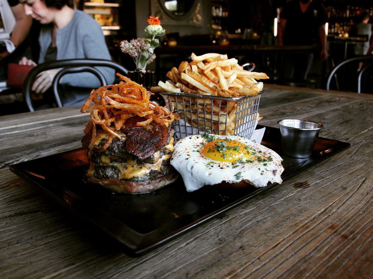 The Wolf Burger with a basket of fries.
