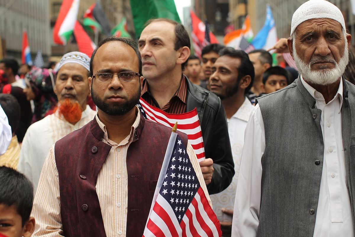 People march in the American Muslim Day Parade on September 26, 2010 in New York, New York.