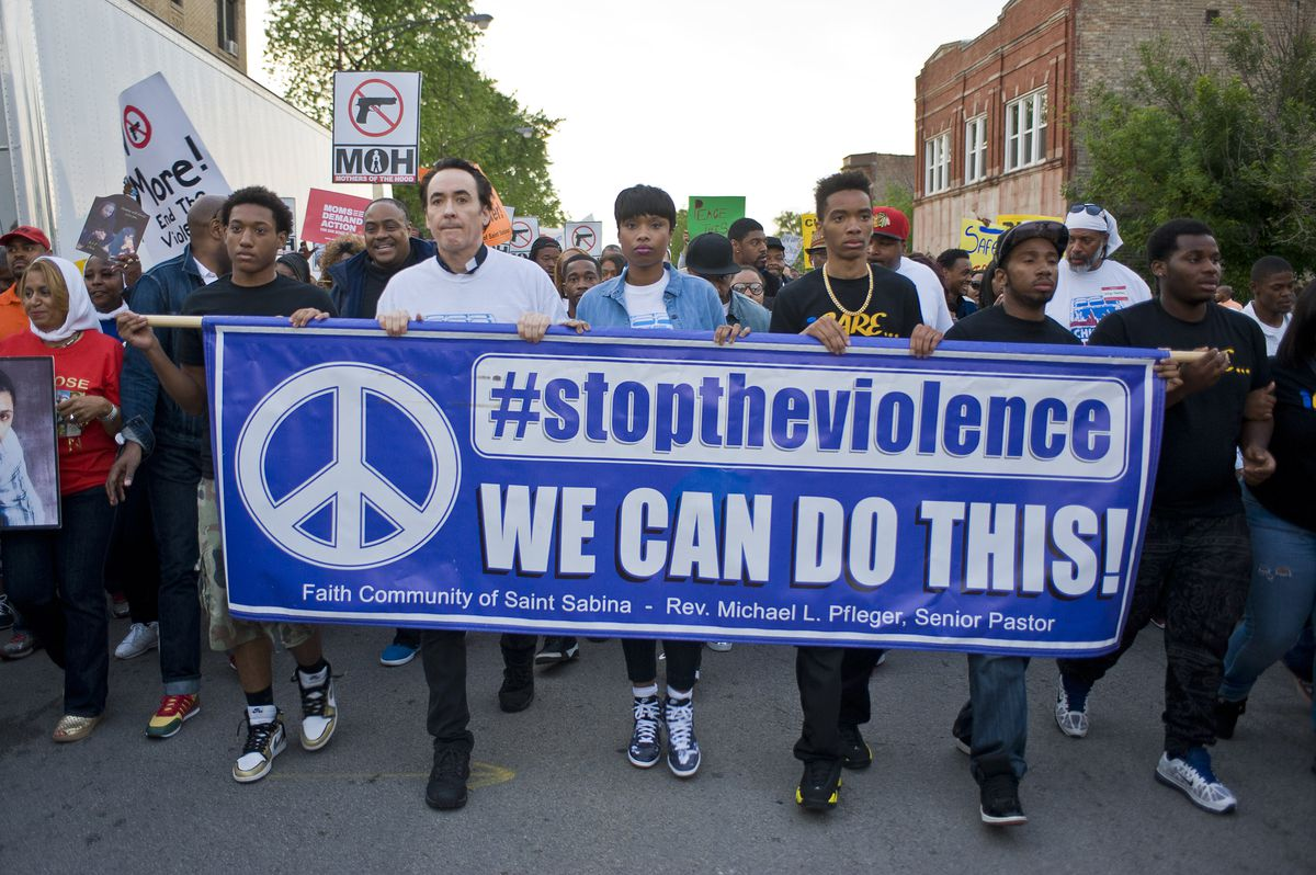 Demonstrators march to end gun violence in Chicago.