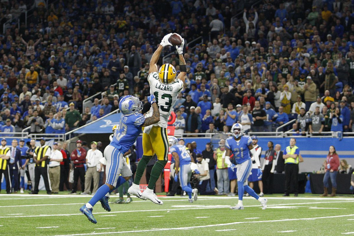 Green Bay Packers wide receiver Allen Lazard makes a touchdown catch against Detroit Lions cornerback Darius Slay during the fourth quarter at Ford Field.