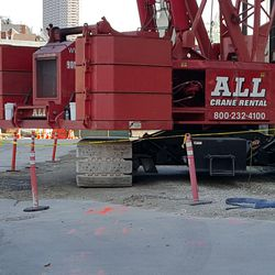 10:59 a.m. Very large crane on Waveland (it's as wide as the street) -