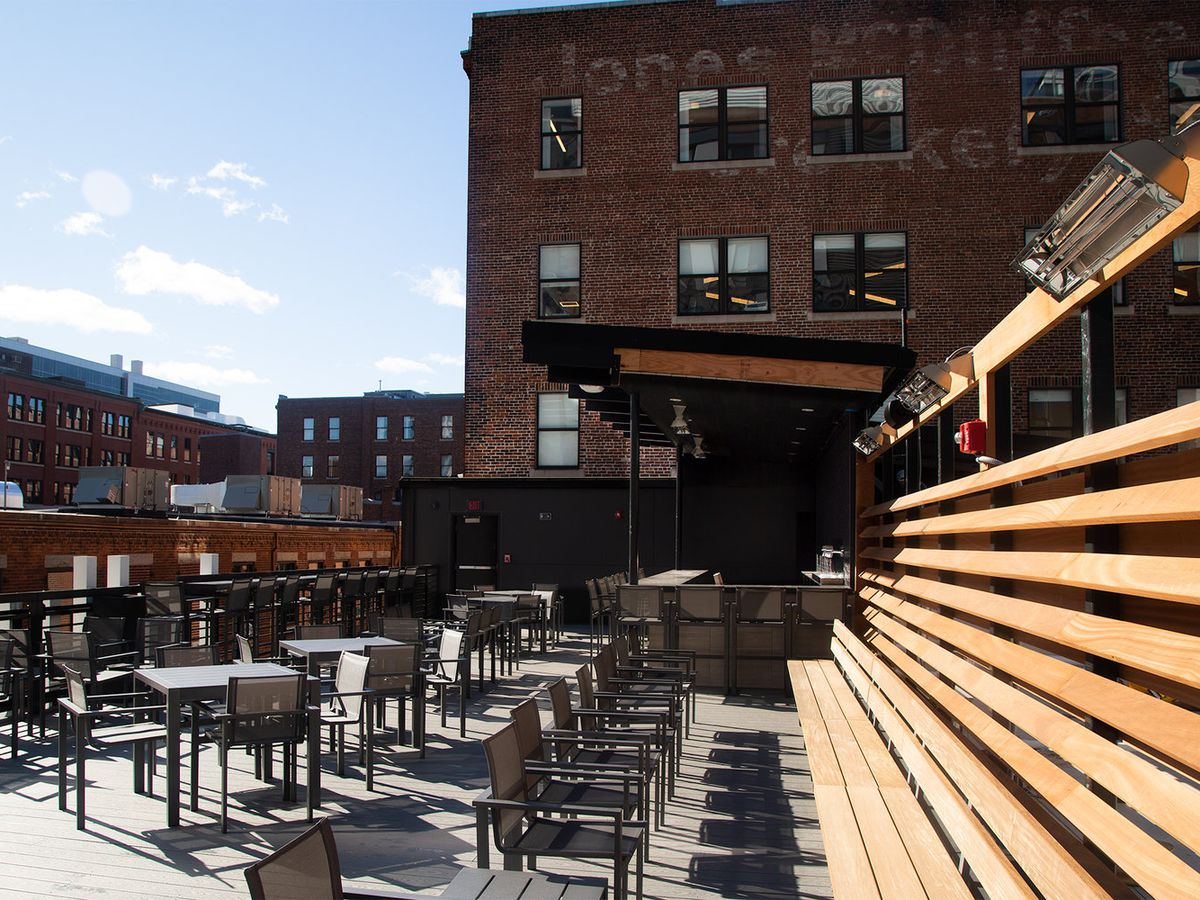 A brewery's spacious roof deck in the city, photographed on a sunny day