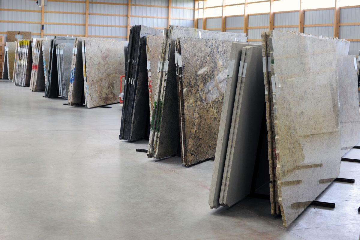 A row of granite countertops in a warehouse.