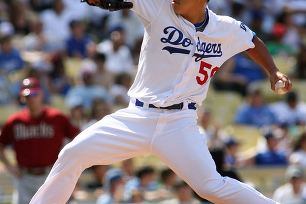 LOS ANGELES, CA - JULY 31:  Hong-Chih Kuo #56 of the Los Angeles Dodgers pitches against the Arizona Diamondbacks in the eighth inning of the game at Dodger Stadium on July 31, 2011 in Los Angeles, California.  (Photo by Jeff Golden/Getty Images)
