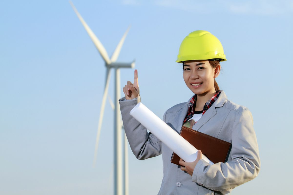 Stock photo model in ill-fitting coat and hard hat wishes she could find a job in renewables.