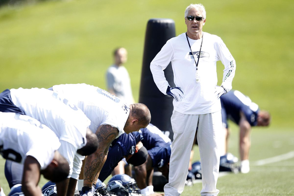 This is a picture of Pete Carroll thinking that he's going to sign Victor Marshall & Benson Mayowa