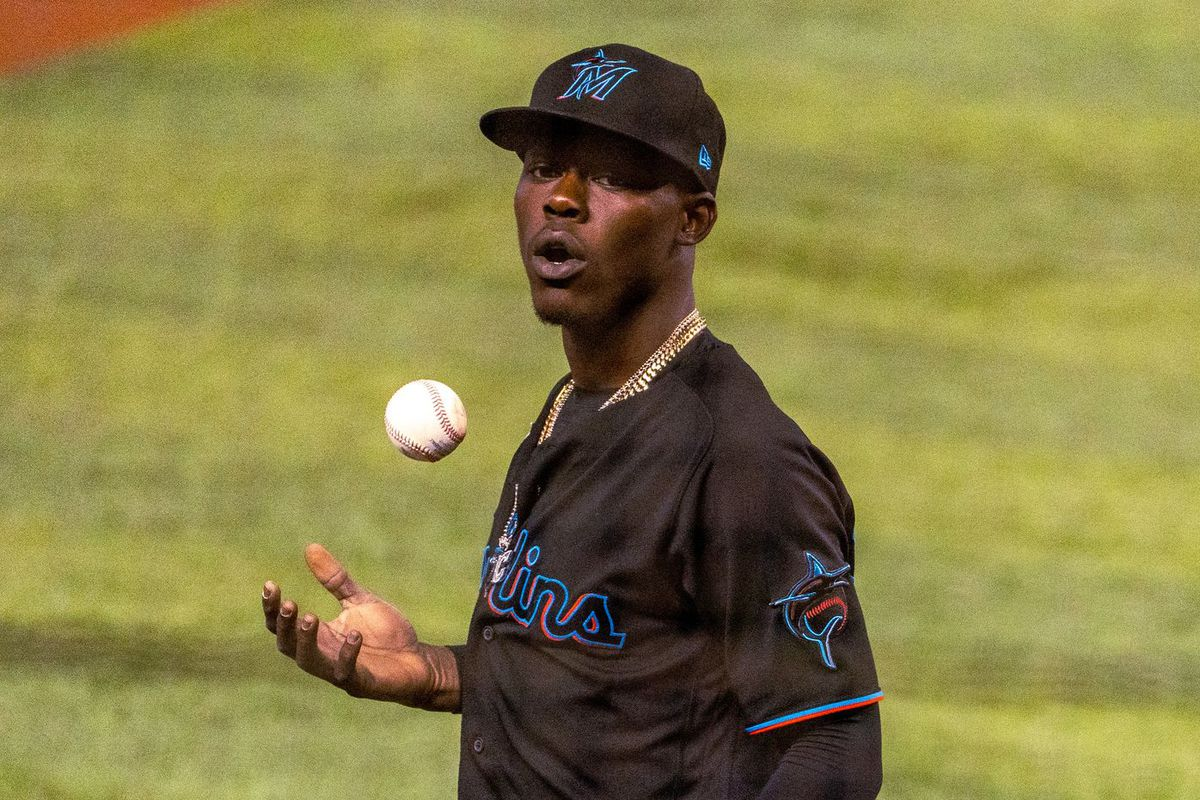 Marlins second baseman Jazz Chisholm Jr. tosses a baseball in his right hand