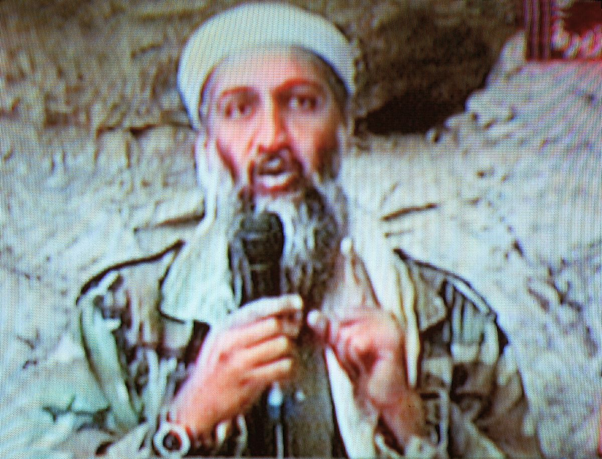 Osama bin Laden seen at an undisclosed location in this television image broadcast October 7, 2001 from Al Jazeera Television in Qatar.