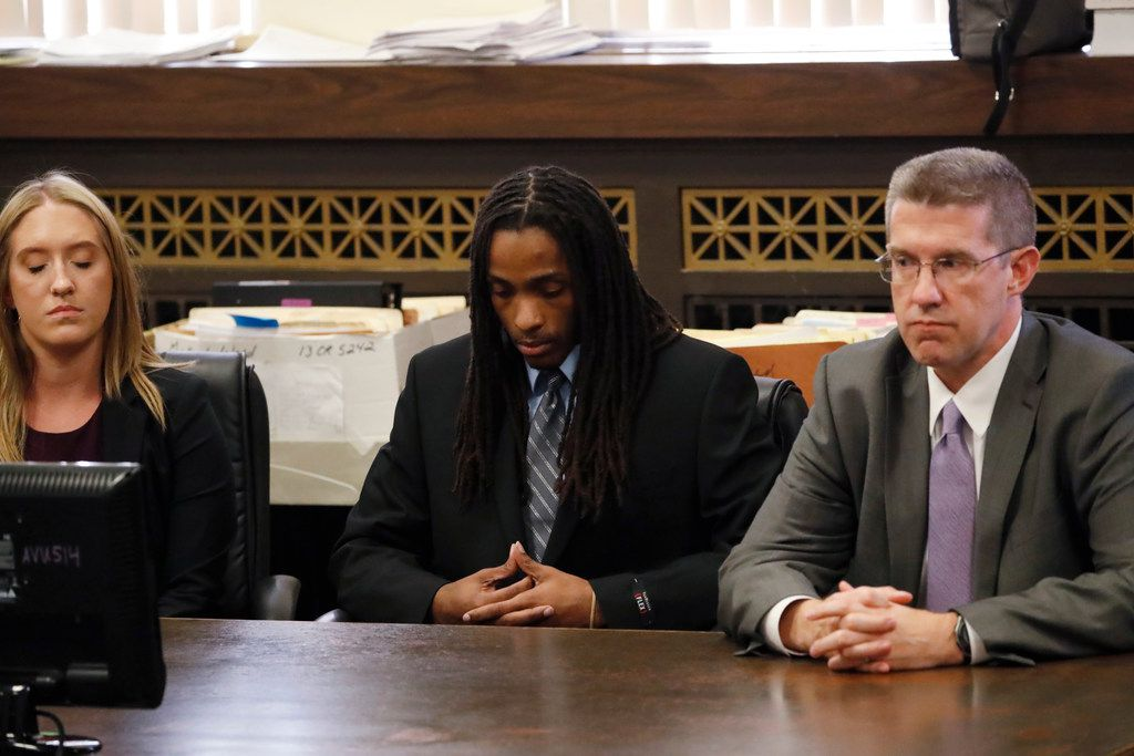 Defendant Kenneth Williams, listens as his guilty verdict is read during the trial for the fatal shooting of Hadiya Pendleton Wednesday. He is flanked by defense assistant Margaret McQuaid and defense attorney Matthew McQuaid. | Jose M. Osorio/Chicago Tri
