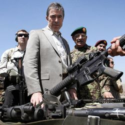 NATO Secretary-General Anders Fogh Rasmussen, center, visits the commando training center in Kabul, Afghanistan, Thursday, April 12, 2012. Rasmussen, said Afghan troops would be ready to take the lead role around the country by mid-2013, allowing international combat forces to move into a support and training role.