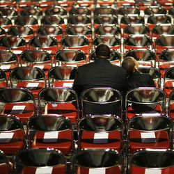 FILE  - In this Friday, June 10, 2016, file photo, Stephfon Moran, left, sits with his grandson, Kevin Slaughter, 9, as they wait for Muhammad Ali's memorial service to begin in Louisville, Ky. For one week last spring, as Louisville led the world in mourning Muhammad Ali's death and celebrating his life, not a single person died in a hail of gunfire in the boxing great's hometown. The silence was welcome in a city wrestling with an explosion of violence