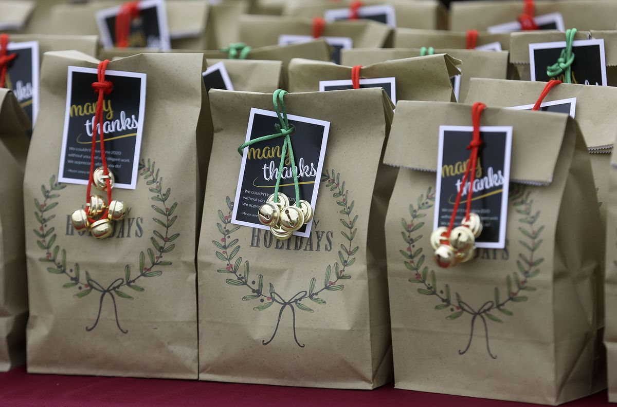 Holiday gift bags are lined up for front-line workers at a COVID-19 testing site outside of the Maverik Center in West Valley City on Tuesday, Dec. 22, 2020. Salt Lake County Mayor Jenny Wilson visited the testing site to thank workers and hand out gift bags.