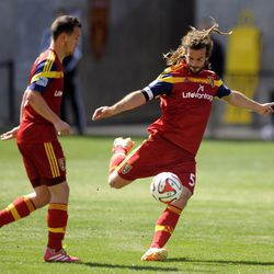 Real Salt Lake midfielder Kyle Beckerman (5) boots the ball during a game at Rio Tinto Stadium on Saturday, March 22, 2014.