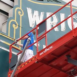 Closeup of painting being done on trim beneath neon light -- not an easy task!