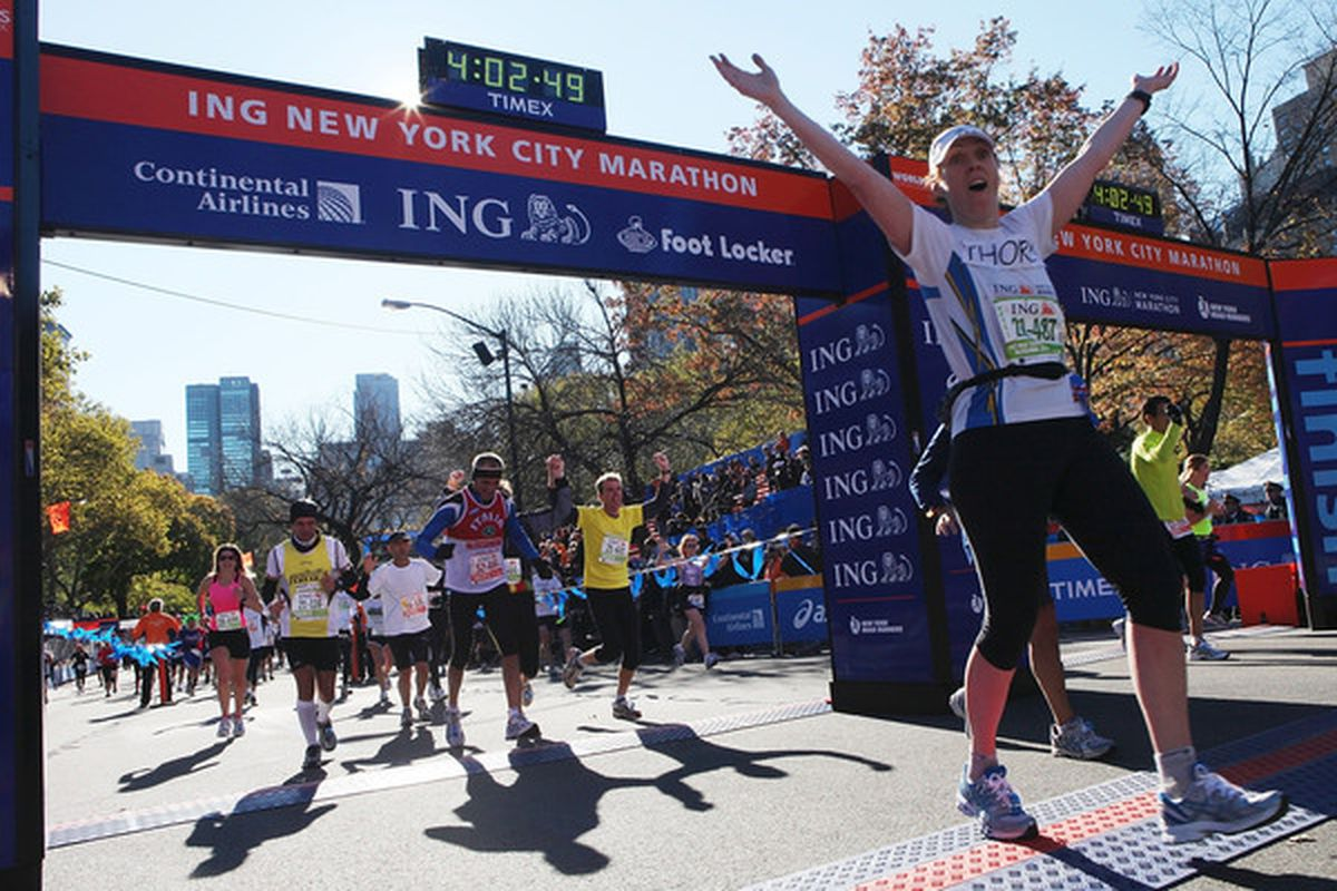 NEW YORK - NOVEMBER 07:  Competitors cross the finish line to complete the 41st ING New York City Marathon on November 7 2010 in New York City.  (Photo by Andrew Burton/Getty Images)