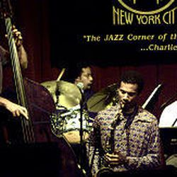 Dave Holland, left, performs with his band at Birdland in New York City in November 2002.