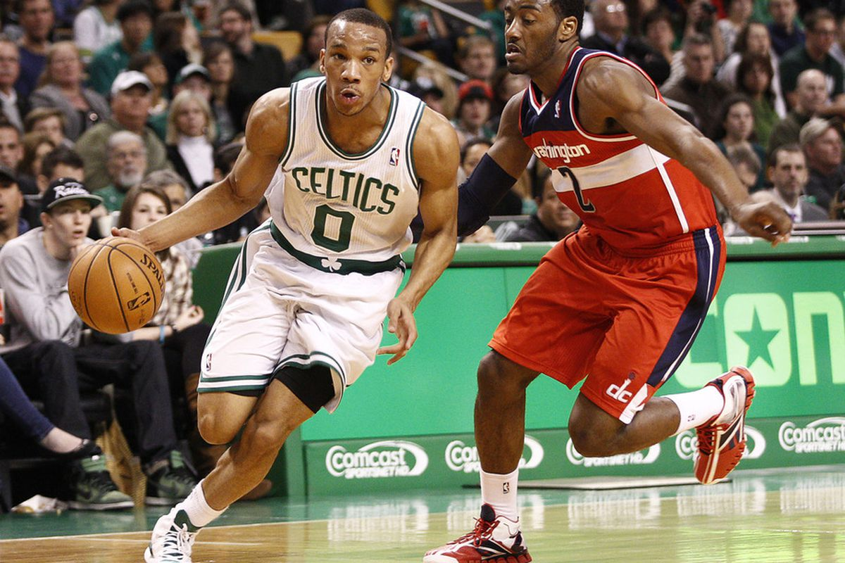 Mar 25, 2012; Boston, MA, USA; Boston Celtics shooting guard Avery Bradley (0) drives to the hoop against Washington Wizards point guard John Wall (2) during the first half at TD Garden.  Mandatory Credit: Mark L. Baer-US PRESSWIRE