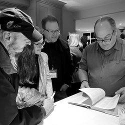 Amy DeCastro, a senior scientist in cancer research, grew up with her father Paul Guertin's love of This Old House. She gifted him an Insider membership for Christmas, and they happened to win tickets to the event—fulfilling Paul's lifelong dream of meeting the cast! They are pictured here with Richard Trethewey as her signs their This Old House book and takes a walk down memory lane.